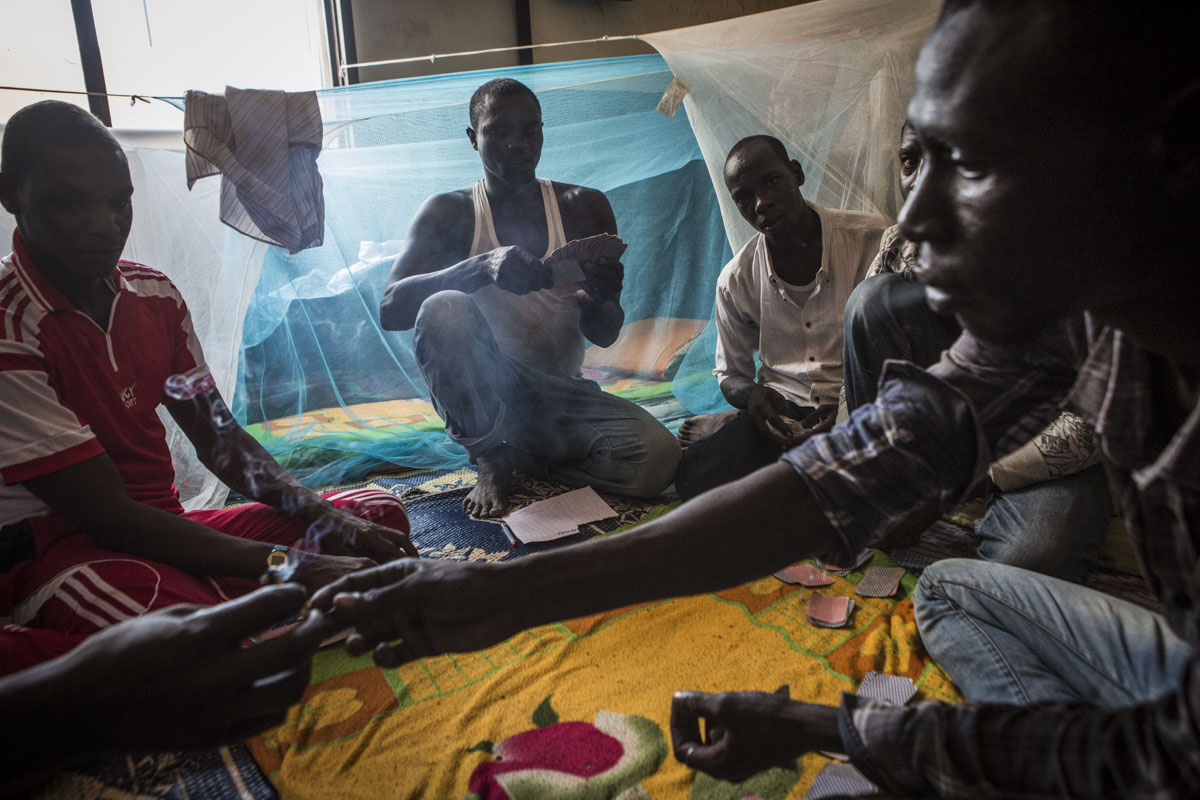 Ex-Boko Haram combatants play cards in a dormitory in an internment camp in Goudoumaria, Niger, August 2018.