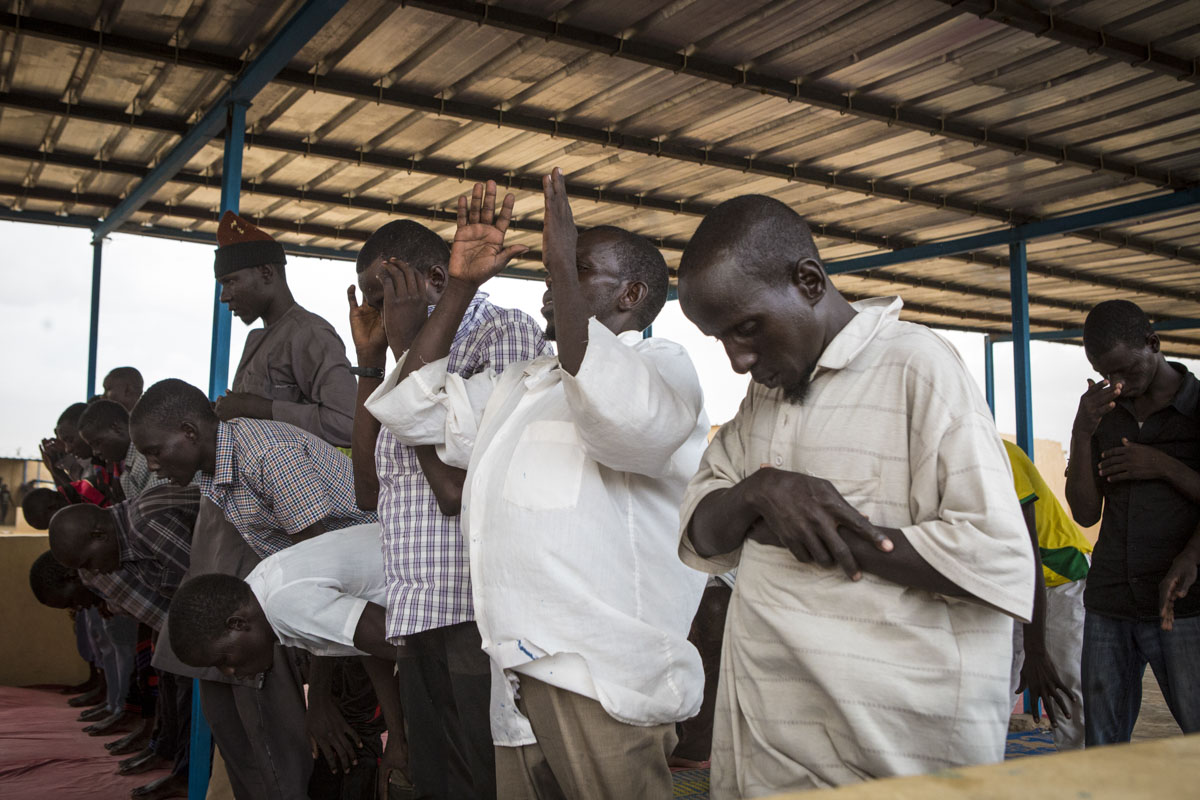 Ex-Boko Harma combatants pray at an internment camp in Goudoumaria, Niger, August 2018.