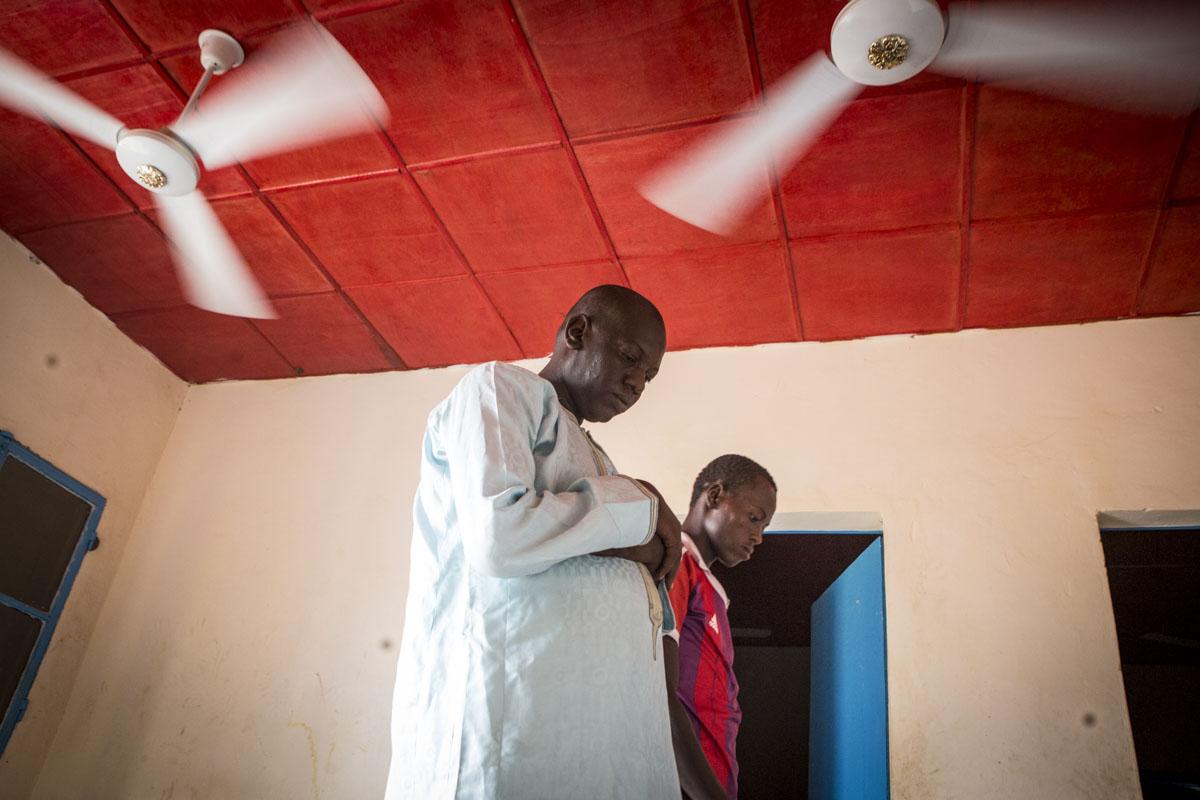 Mustafa Abboubacar, 27, prays at an internment camp for ex-Boko Haram combatants in Goudoumaria, Niger, August 2018.
