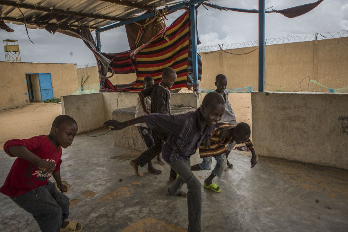Children play soccer at an internment camp for ex-Boko Haram combatants in Goudoumaria, Niger, August 2018.