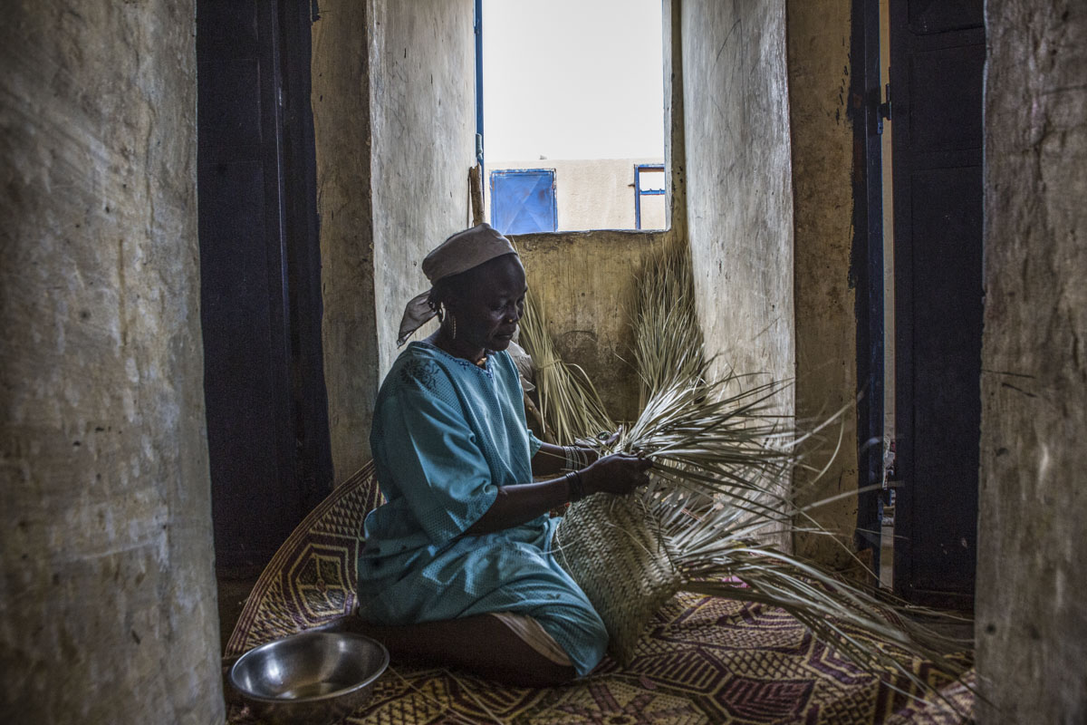 Zara, 40 weaves a straw mat at an internment camp for ex-Boko Haram combatants in Goudoumaria, Niger, August 2018. Shettima has spent over one year in the camp.