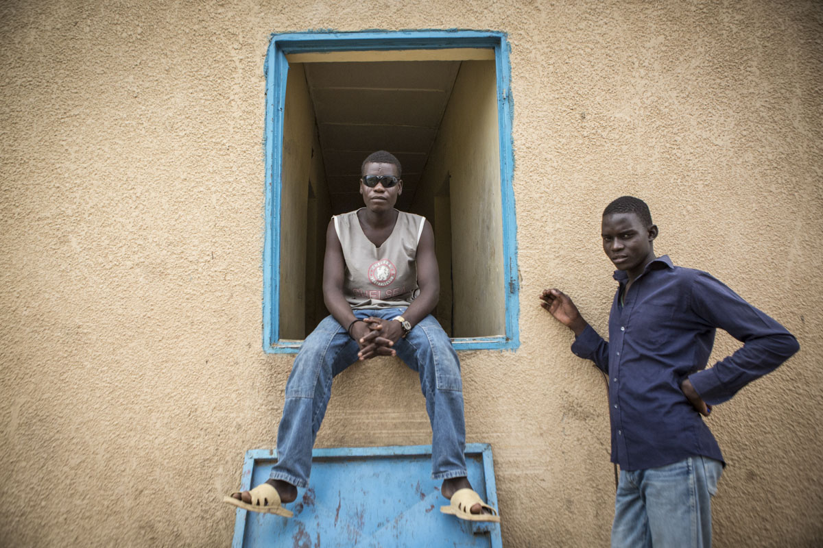 Malam, 26 (c) and Alhaji, 23, (r)  at an internment camp for ex-Boko Haram combatants in Goudoumaria, Niger, August 2018.