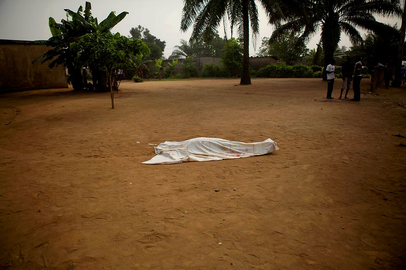 the body of a man lies on the road in abobo