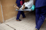 the body of a man is brought into a morgue in abidjan, ivory coast