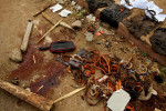 amulets worn for protection, clothing and other belongings are displayed across a blood stained street after heavy fighting between pro-ouatrrara supporters and security forces loyal to laurent gbagbo in abobo