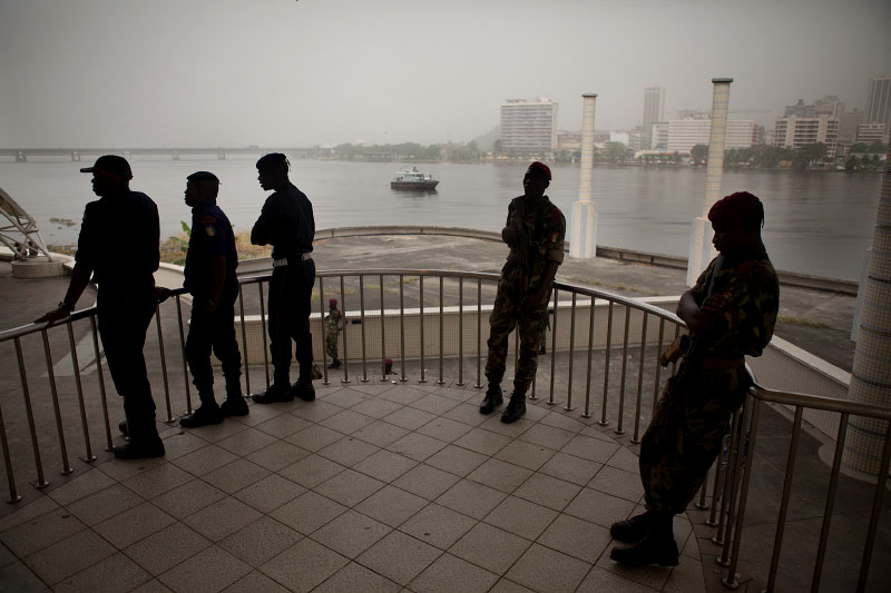 Security forces guard a pro-Gbagbo rally in Abidjan in March 2011.