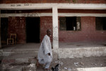 A man walks passed a classroom at the Ali Alyaskari Primary School in Maiduguri, Nigeria. 2013