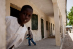 Young boys play outside a classroom at the Ali Alyaskari Primary School in Maiduguri, Nigeria. The Ali Alyaskari Primary School, already lacking funds for supplies, esp. desks for students, was attacked by Boko Haram in late March.