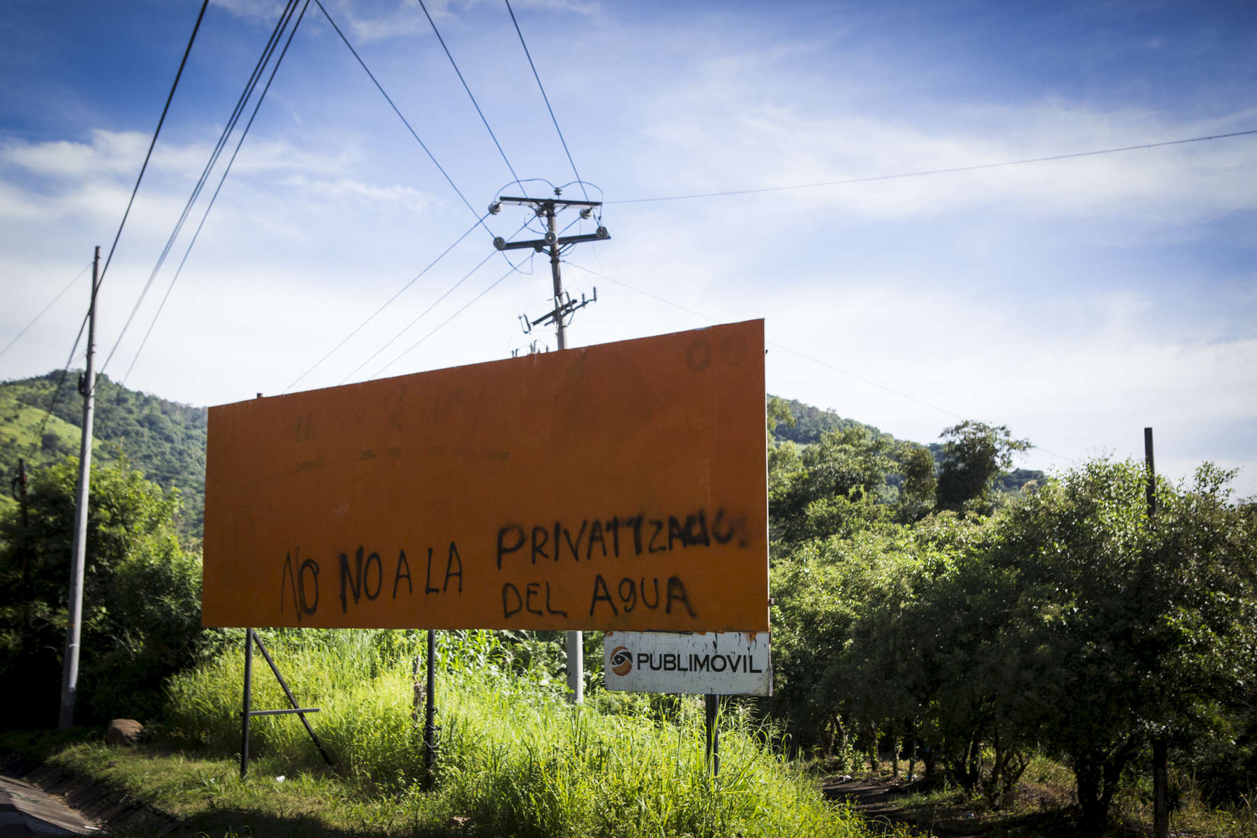 Tanacatepeque, El Salvador- A billboard with the message {quote}No to the privatization of water{quote} along the road in Tanacatepeque, El Salvador on Sunday, June 24, 2018. (Jane Hahn)