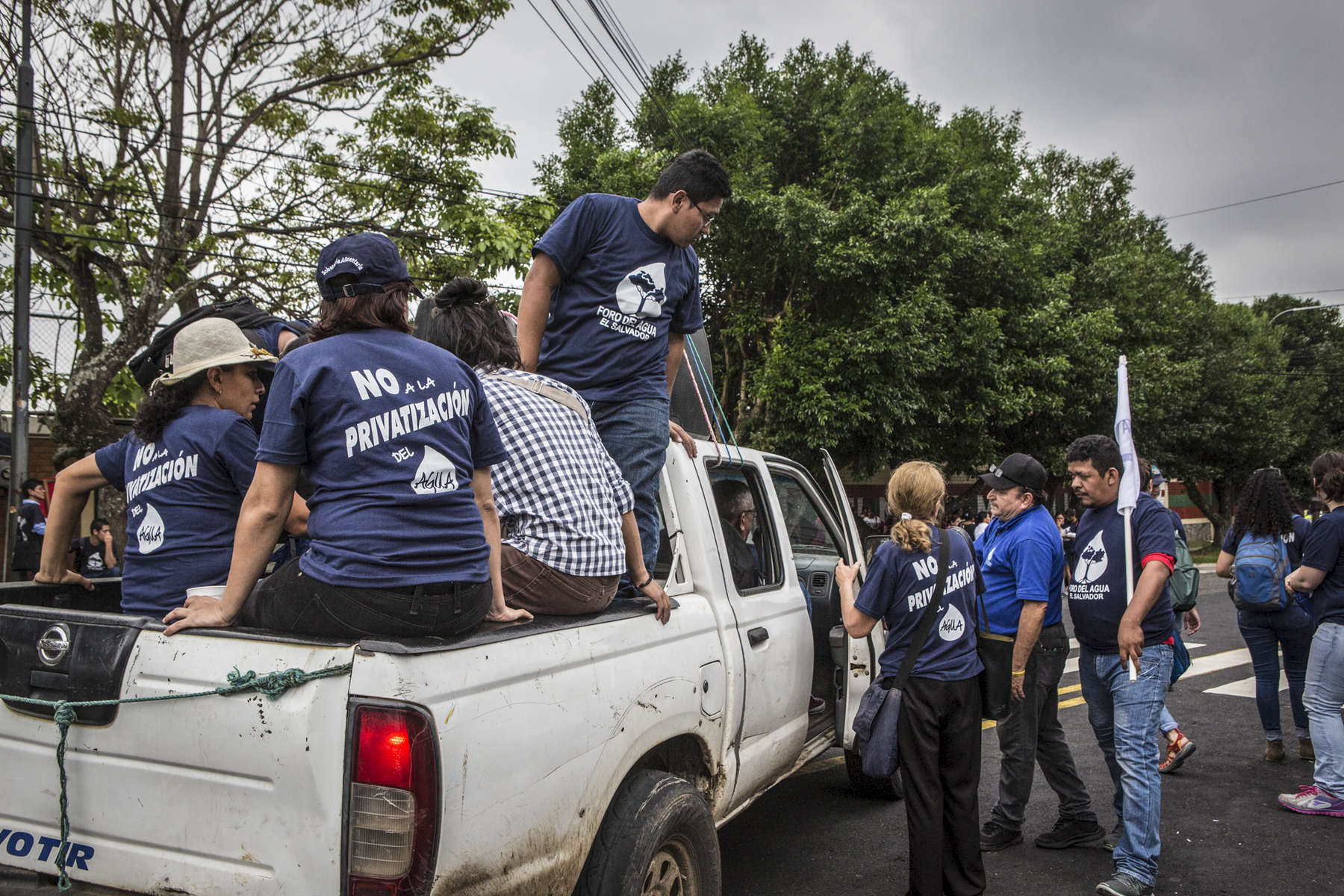 San Salvador, El Salvador- Protesters gather outside the office to pressure lawmakers from approving the right wing {quote}Comprehensive Water Law{quote} in San Salvador, El Salvador on Thursday June 21, 2018. (Jane Hahn)