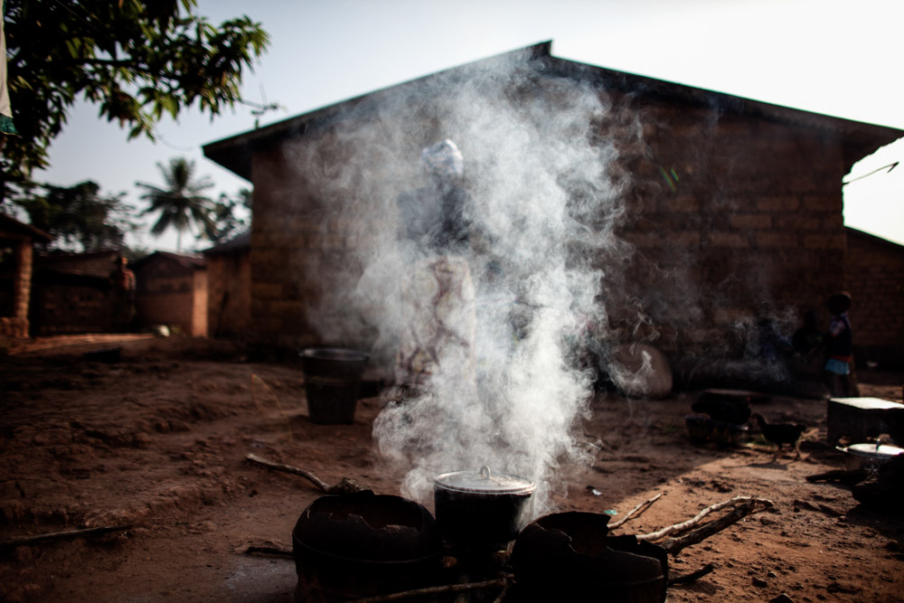 A woman prepares food in Meliandou, Guinea on January 25, 2015.
