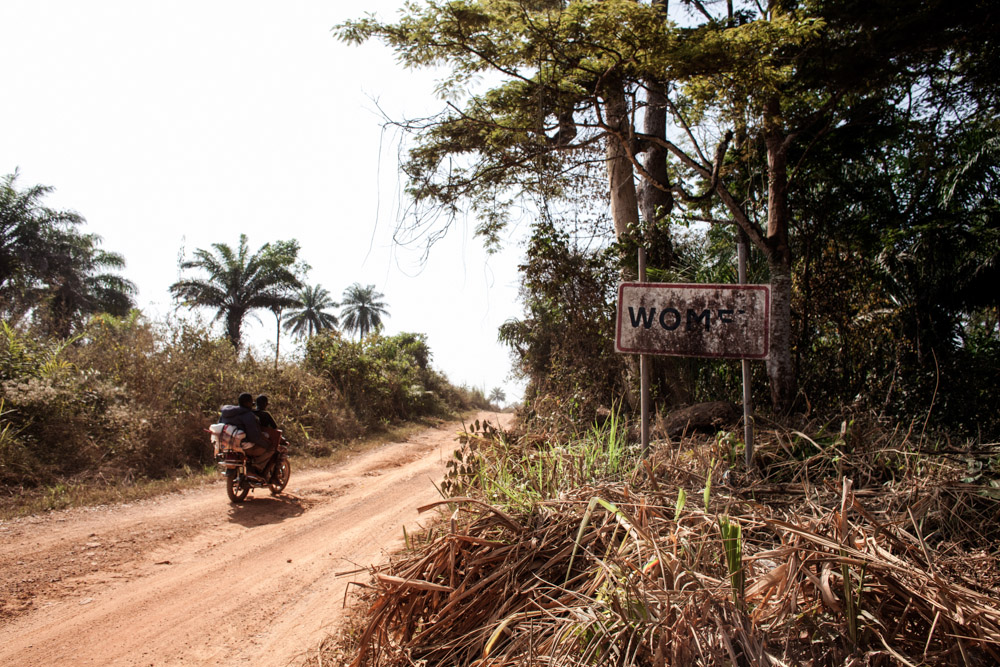 A sign marks the entrance to Womey, Guinea on January 24, 2015. On September 16, 2014, a team of government employees, journalists and health care workers entered Womey to educate the people about Ebola when the group was attacked and eight people were brutally killed.