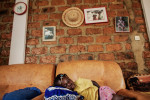 Reverend Moises Mamy's granddaughter sleeps in their home in N'zao, Guinea on January 23, 2015. Reverend Moises Mamy was one of eight people killed on September 16, 2014 while visiting the town of Womey in an attempt to educate people about Ebola.