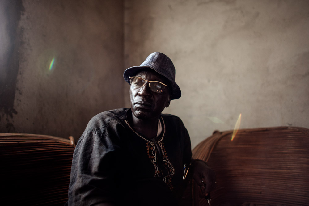 Nyamkoye Haba, 60, sits in the Haba family home in Womey, Guinea on January 24, 2015. Haba was one of many arrested for the killing of eight people, part of a larger government led group who entered Womey to educate people about Ebola on Septemebr 16, 2014. Haba was later released and cleared of charges after spending three months in prison.