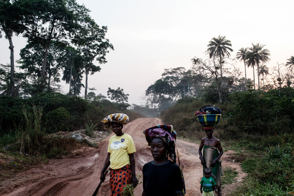 Women return from their farms outside of Gouéké, Guinea