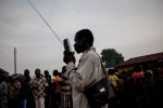 A man listens to the radio in N'zebela, Guinea on January 22, 2015. Most people in the forested region of Guinea receive news through the radio due to high levels of illiteracy.