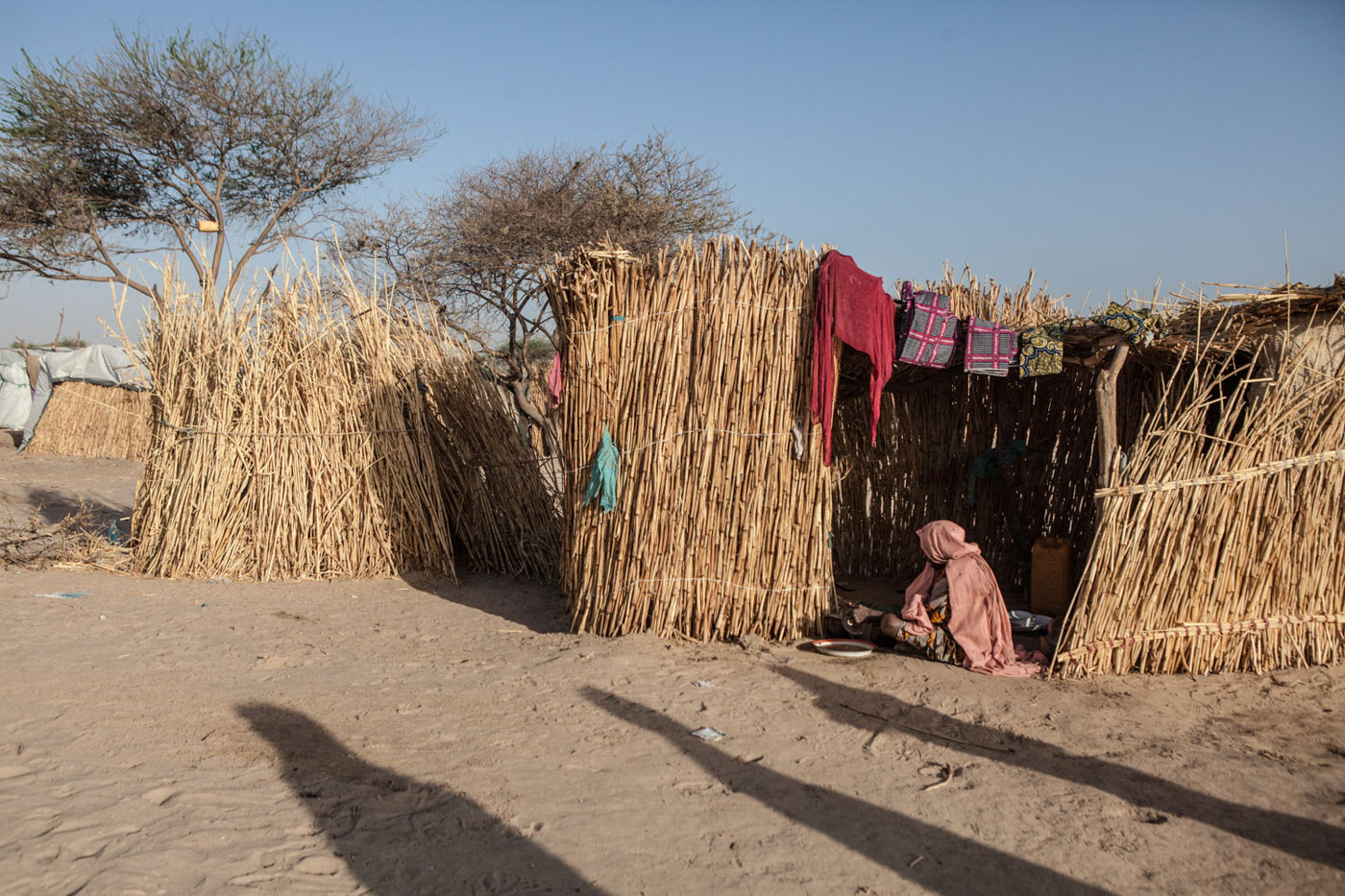 A woman sits outside of her hut in Kindjandi in Diffa, Niger.