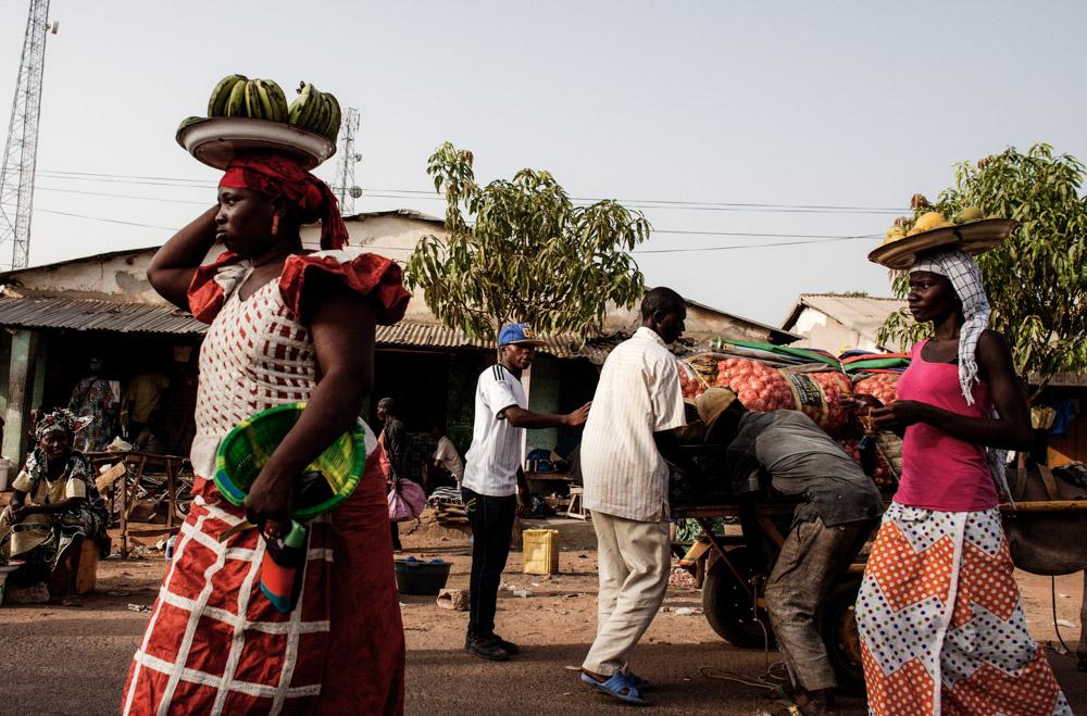 People walk through the market in Brikama-ba Village, Gambia
