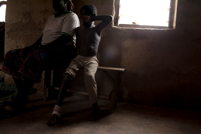 Bulus Tegwai, 7, was shot in the foot when trying to escape an attack on his village, Ranuiaku.