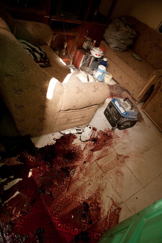 Blood stains the floor in the home where Uzairu Abba Abdullahi and his wife were killed in an overnight raid by Nigerian security forces, who accused him of being a member of Boko Haram, in the Tsamiyar Boka neighborhood in Kano, Nigeria. 2012