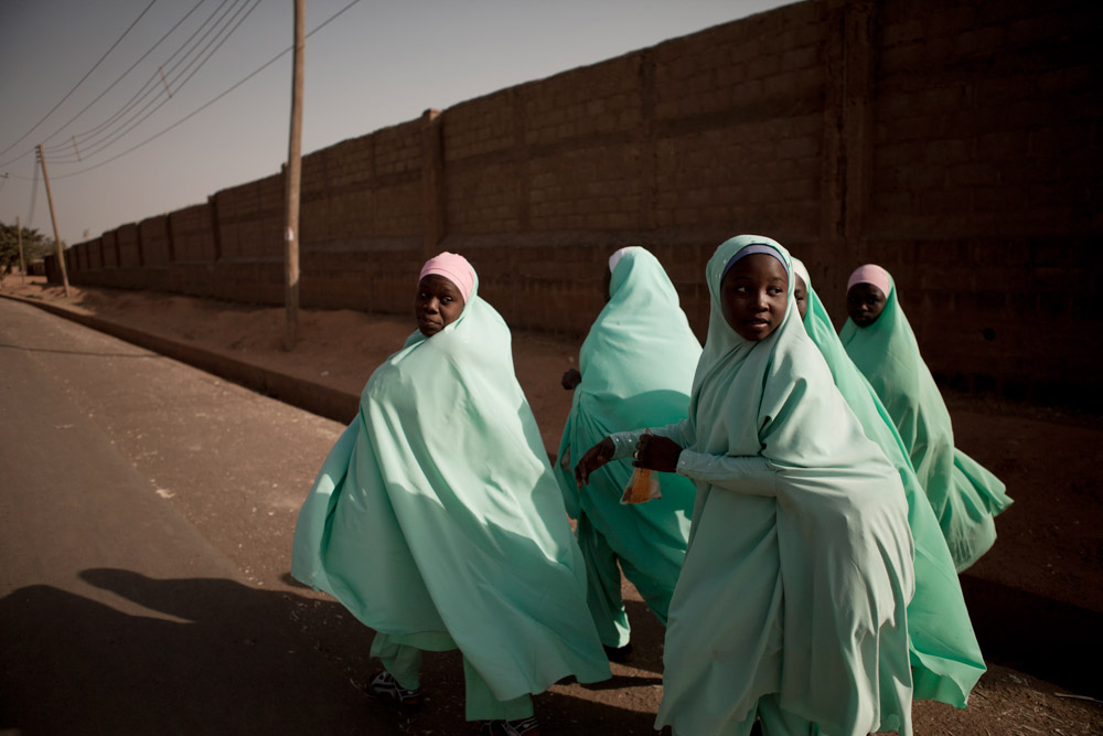 School girls walk through Kano, Nigeria days after 22 bombs were set off by Boko Haram killing over 150 people in January 2012