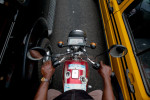 a motorbike taxi rides between lanes in lagos, nigeria
