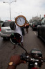 a man sells clocks in traffic in lagos, nigeria