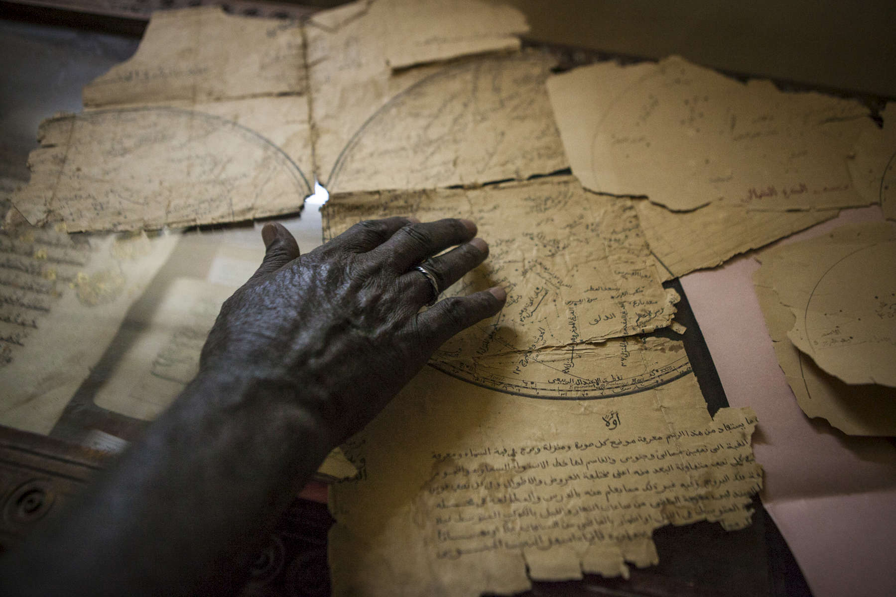 A librarian displays an astronomy manuscript at the Manuscript Library in Timbuktu, Mali on Monday, January 9, 2017. While Timbuktu was occupied, scores of manuscripts were destroyed but through an international effort, the majority of manuscripts were smuggled out of the city and saved.