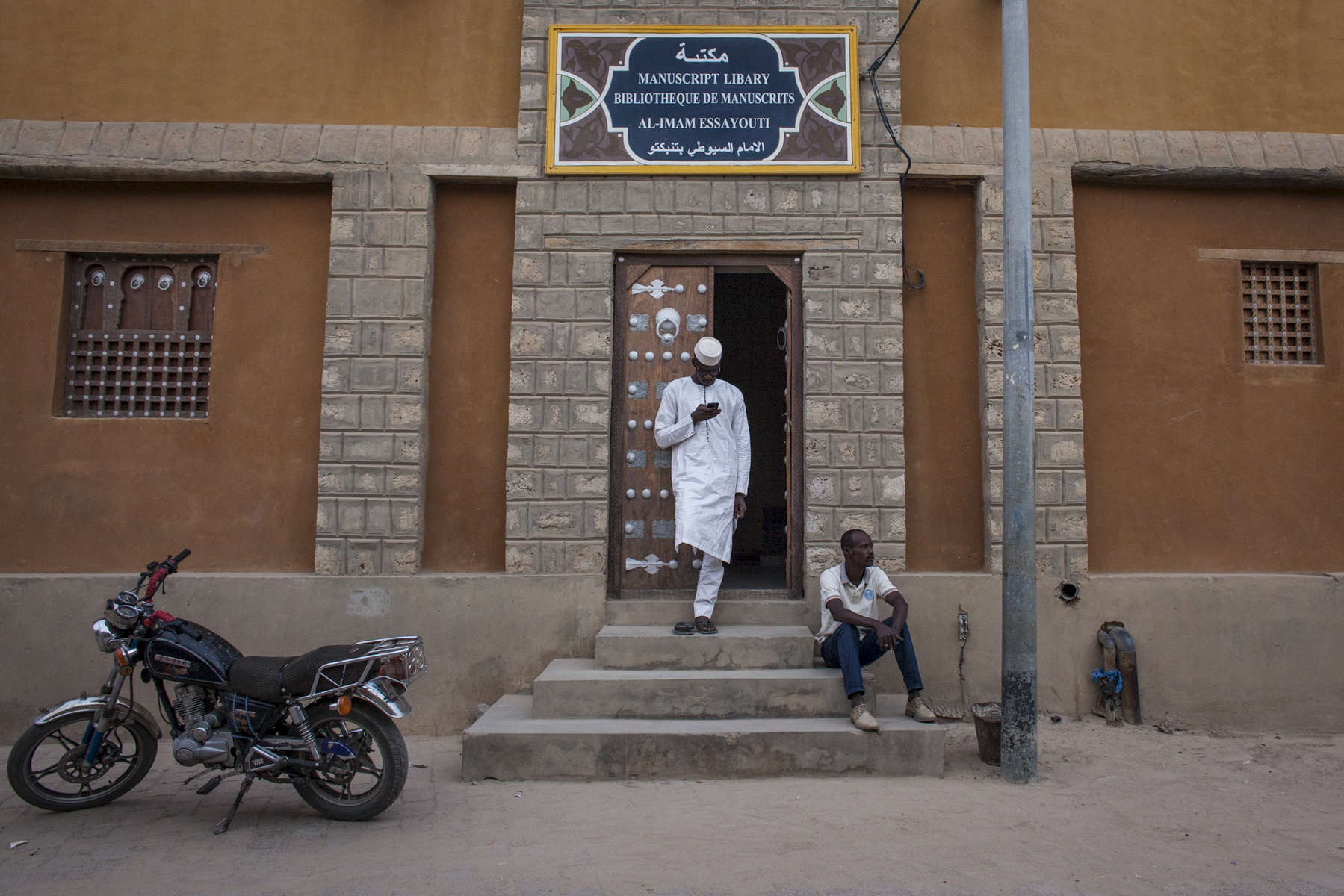 Men stand outside of the Manuscript Library in Timbuktu, Mali on Monday, January 9, 2017.