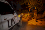 A United Nations Policeman stands on guard during a night patrol in the Abaradiou neighborhood in Timbuktu, Mali on Monday, January 9, 2017. Despite the end of the occupation, many Malians in Timbuktu find that security is still a major issue speaking of incidents of car jacking and looting. Even though crime is high, most of the deadly attacks that occur are against the United Nations Minusma mission, Malian soldiers and the French military.