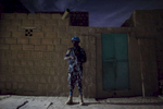 A United Nations police officer stands on guard during a night patrol in the Abaradiou neighborhood in Timbuktu, Mali. Despite the end of the occupation, many Malians in Timbuktu find that security is still a major issue speaking of incidents of car jacking and looting. Even though crime is high, most of the deadly attacks that occur are against the United Nations Minusma mission, Malian soldiers and the French military.