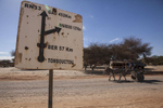 A sign post measuring the distance between Timbuktu and other northern towns on the outskirts of Timbuktu, Mali on Tuesday, January 10, 2017.