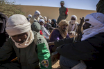 Members of former rebel groups part of the peace process wait to be registered in the MOC at a local police station in Gao, Mali on Friday, January 13, 2017. Close to 150 men wait to be registered in the MOC (Mécanisme Opérationnel de Coordination) but the process has been delayed due to the number of men exceeding the original amount registered as well as demands of insurance and pay by the men. The MOC will be comprised of the Malian military as well as former members of rebel groups who are a part of the peace agreement. Joint patrols will take place in Gao, Timbuktu and Kidal with Gao being the first city to implement these patrols, the first steps in accomplishing the peace process.