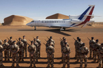 French troops part of Operation Barkhane stand at attention as French President Francois Hollande's private jet lands in Gao, Mali on Friday, January 13, 2017.