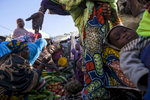 Women buy fresh produce at the market in Gao, Mali on Sunday, January 15, 2017.