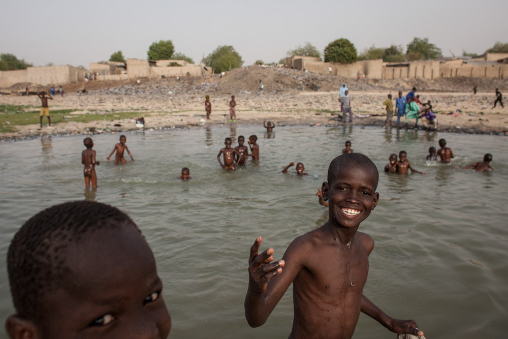 Children play by the river in Maiduguri, Nigeria