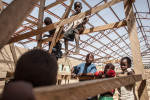 Children play on the scaffolding of an unfinished building at the Internally Displaced Persons Camp at the Divisional Council Church in Maiduguri, Nigeria