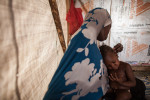 Hamsatu, 25, plays with her daughter Hauwa, 1, in her tent at Dalori Internally Displaced Persons Camp in Maiduguri, Nigeria