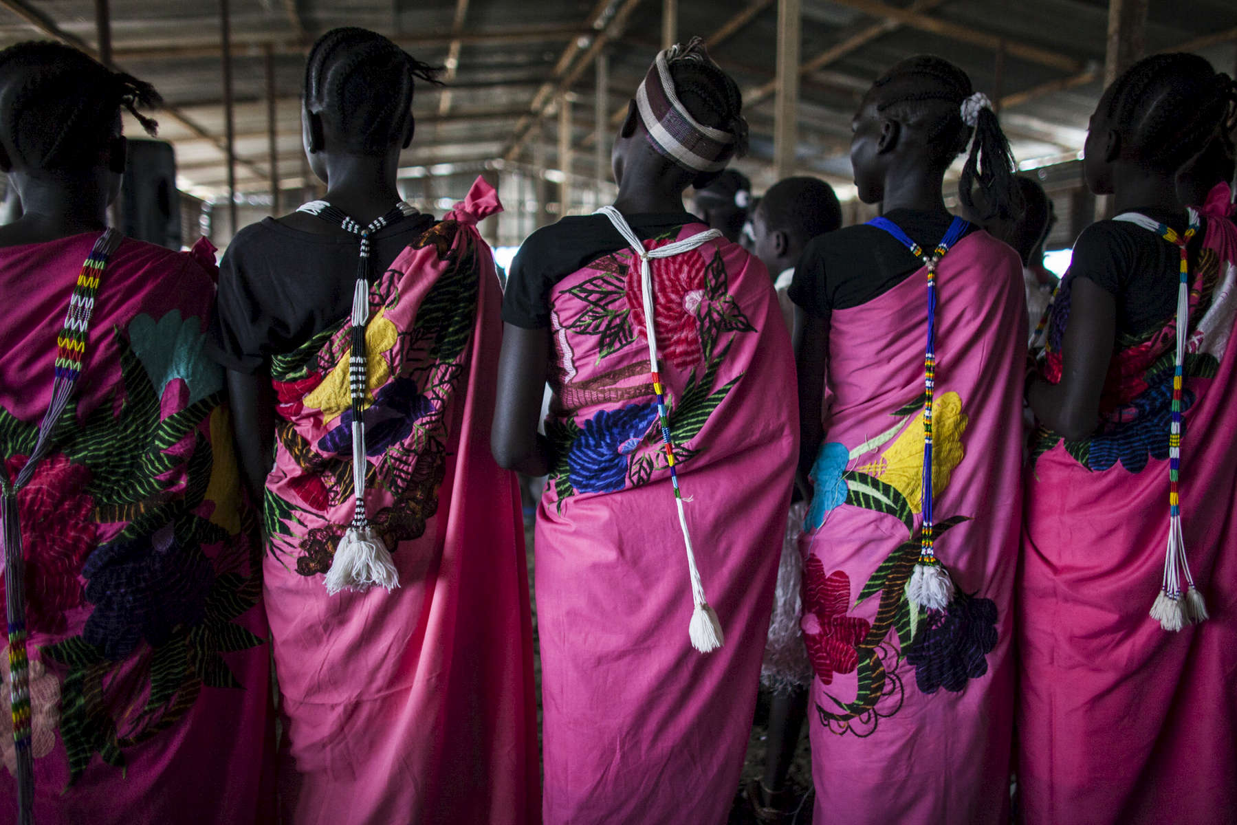 Church members pray at the Dolieb Hill Presbyterian Church in the Protection of Civilians (POC) site at the United Nations Mission in South Sudan (UNMISS) compound in Malakal, South Sudan on Saturday, July 9, 2016. The Malakal POC site houses over 32,000 displaced people mainly from the Shilluk and Nuer tribes. In February of this year, members of the Dinka tribe, who resided in the camp at the time, carried out a coordinated attack within the site leading to the destruction of hundreds of shelters and many deaths. Since then, most members of the Dinka tribe have fled to Malakal town where they occupy the homes of those still displaced.