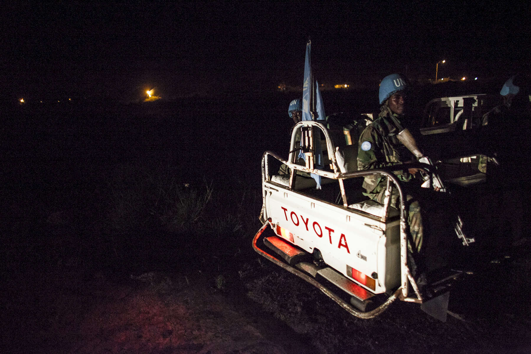 The Rwandan Battalion of the United Nations Peacekeepers patrols the perimeter of the Protection of Civilians (POC) site and the United Nations Mission in South Sudan (UNMISS) compound during a night patrol in Malakal, South Sudan on Monday, July 11, 2016. The UN has assured the displaced people that increased security measures around the camp will protect them from any further attack. Most of the displace are not convinced. The Malakal POC site houses over 32,000 displaced people mainly from the Shilluk and Nuer tribes. In February of this year, members of the Dinka tribe, who resided in the camp at the time, carried out a coordinated attack within the site leading to the destruction of hundreds of shelters and many deaths. Since then, most members of the Dinka tribe have fled to Malakal town where they occupy the homes of those still displaced.