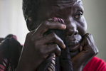 Mary Akich, 38, cries while recounting the circumstances around her son's death during the coordinated attack on February 17th and 18th of this year in the Protection of Civilians (POC) site at the United Nations Mission in South Sudan (UNMISS) compound in Malakal, South Sudan on Tuesday, July 12, 2016. The Malakal POC site houses over 32,000 displaced people mainly from the Shilluk and Nuer tribes. In February of this year, members of the Dinka tribe, who resided in the camp at the time, carried out a coordinated attack within the site leading to the destruction of hundreds of shelters and many deaths. Since then, most members of the Dinka tribe have fled to Malakal town where they occupy the homes of those still displaced.