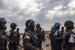 Members of the United Nations Police prepare to search the Protection of Civilians (POC) site of contraband at the United Nations Mission in South Sudan (UNMISS) compound in Malakal, South Sudan on Friday, July 15, 2016. The Malakal POC site houses over 32,000 displaced people mainly from the Shilluk and Nuer tribes. In February of this year, members of the Dinka tribe, who resided in the camp at the time, carried out a coordinated attack within the site leading to the destruction of hundreds of shelters and many deaths. Since then, most members of the Dinka tribe have fled to Malakal town where they occupy the homes of those still displaced. The UN has assured the displaced people that increased security measures around the camp will protect them from any further attack. Most of the displace are not convinced.
