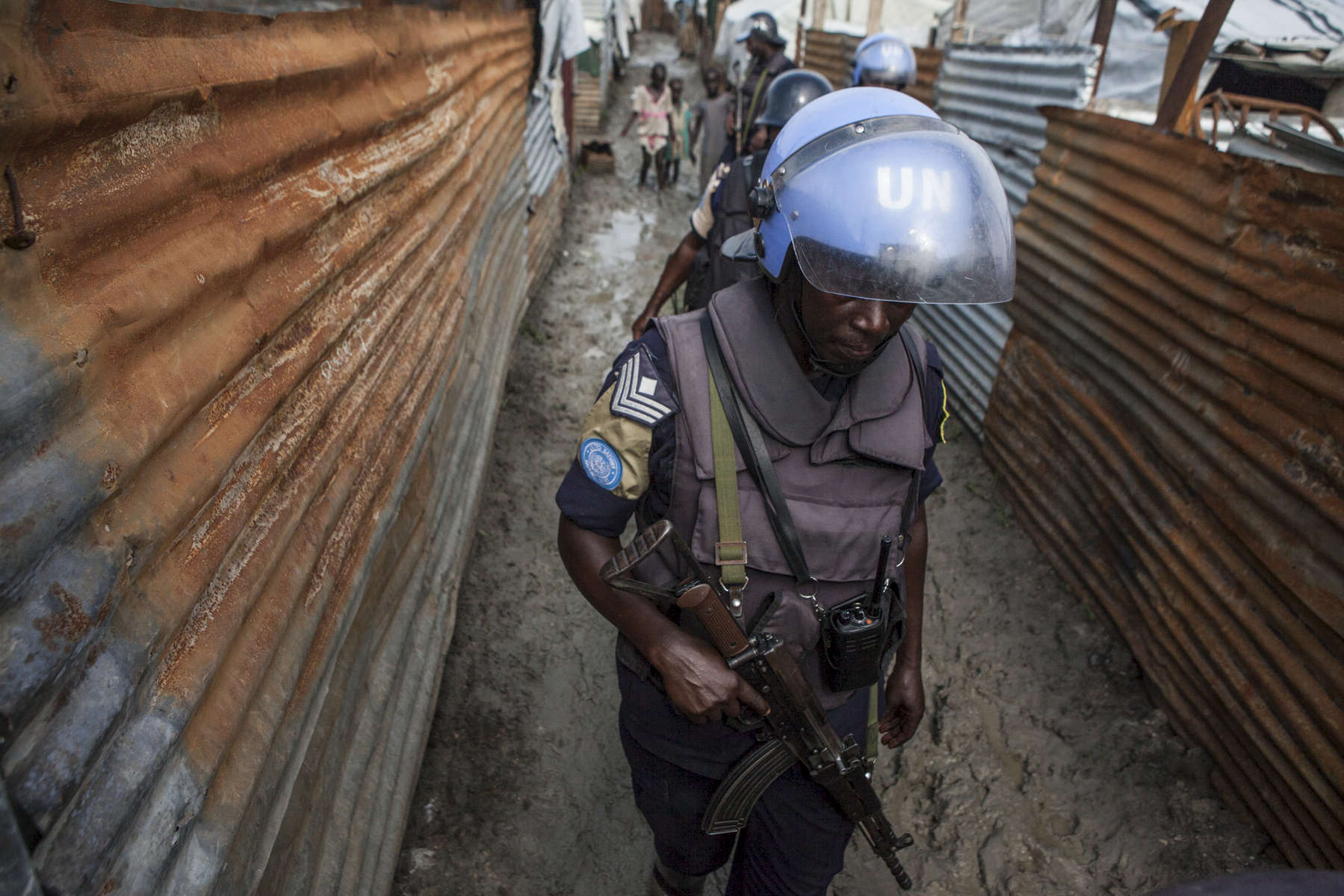 Members of the United Nations Police patrol the Protection of Civilians Site searching for contraband in Malakal, South Sudan on Friday, July 15, 2016