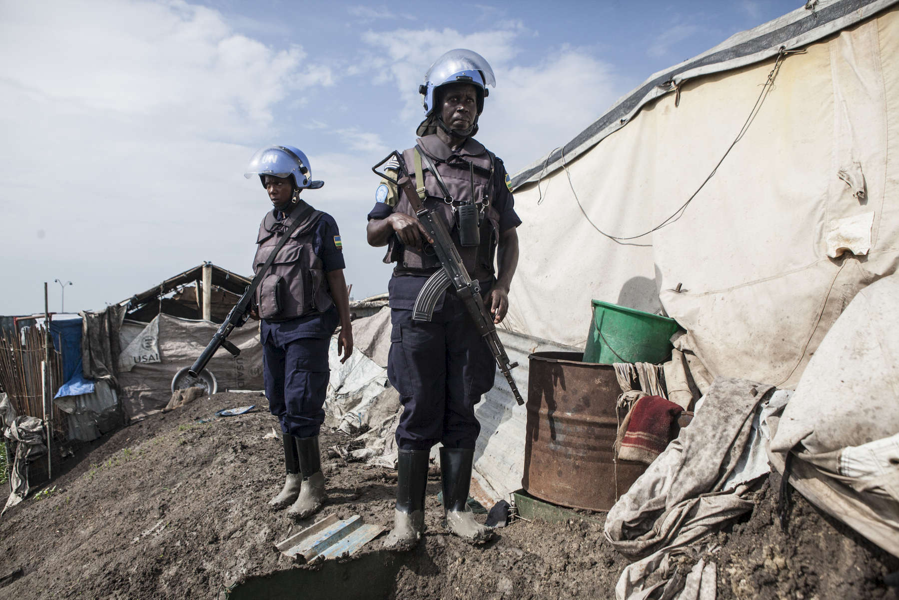 Members of the United Nations Police, UNPOL, search shelters for contraband in the Protection of Civilians (POC) site at the United Nations Mission in South Sudan (UNMISS) compound in Malakal, South Sudan on Friday, July 15, 2016. The Malakal POC site houses over 32,000 displaced people mainly from the Shilluk and Nuer tribes. In February of this year, members of the Dinka tribe, who resided in the camp at the time, carried out a coordinated attack within the site leading to the destruction of hundreds of shelters and many deaths. Since then, most members of the Dinka tribe have fled to Malakal town where they occupy the homes of those still displaced. The UN has assured the displaced people that increased security measures around the camp will protect them from any further attack. Most of the displace are not convinced.