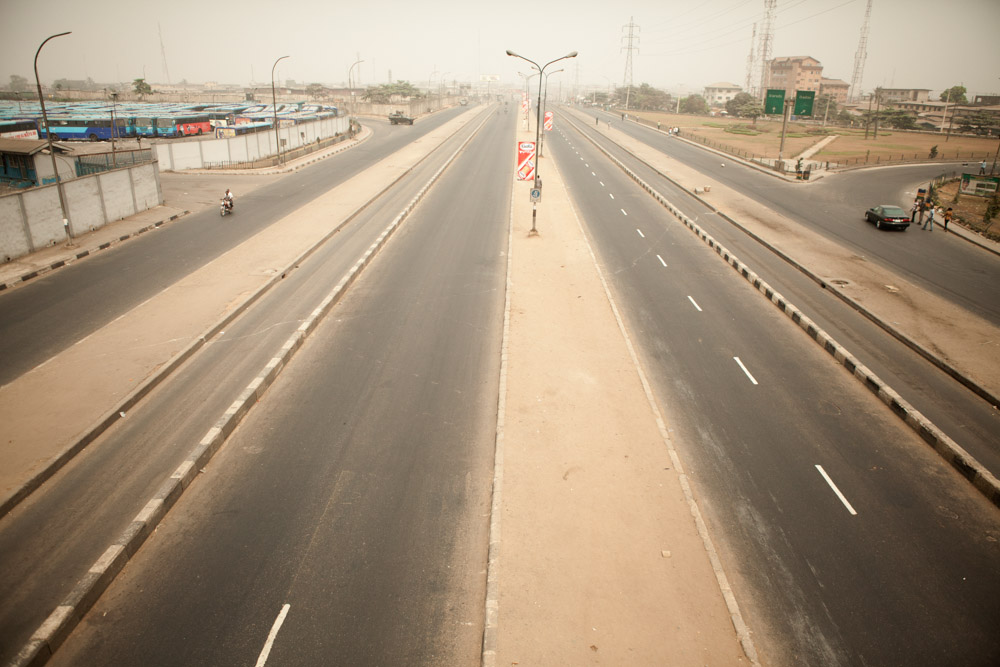 The empty streets of Lagos, Nigeria during a country wide {quote}stay at home{quote} strike after the government removed fuel subsidies causing gas prices to double at filling stations.