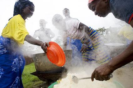Volunteers cook lunch at St. Dominic's School in Bomi, Liberia