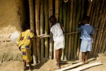 Children stand outside of class at the Kamanda Town Community School, Liberia