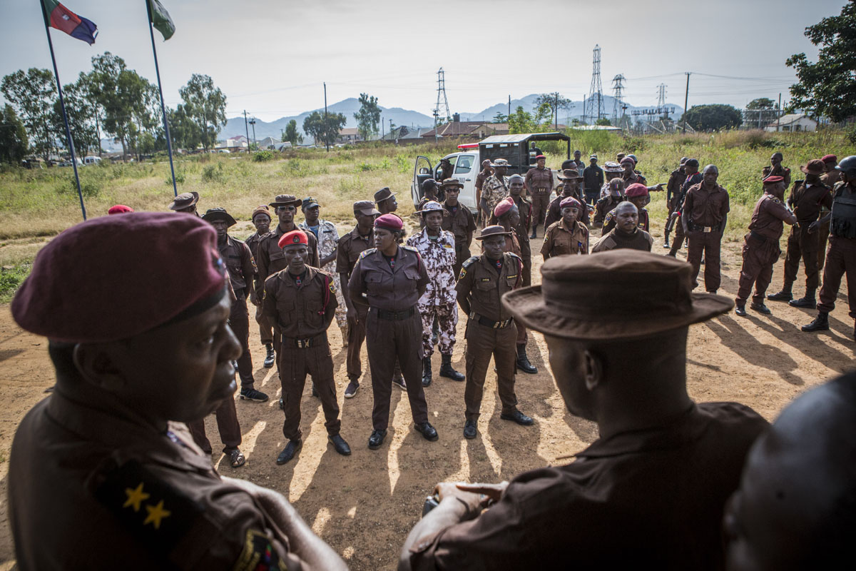 Barkin Ladi, Jos, Nigeria- Members of the Vigilante Group of Nigeria, Barkin Ladi Division, stand at attention before leaving their base for patrols and checkpoint duties in Barkin Ladi, Nigeria on Monday, October 22, 2018. Growing animosity between ethnic groups coupled with a lack of security  has fomented an increase in violence in recent years. Despite the divisive chaos engulfing the Middle Belt of Nigeria, a group of multi-ethnic men and women, part of the Vigilante Group of Nigeria, are providing much needed security and trust to all groups affected by the conflict.