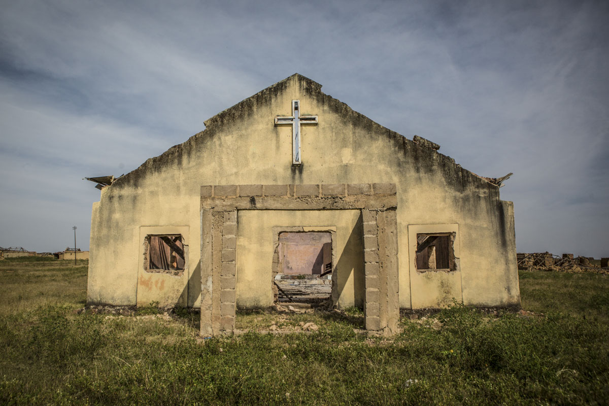Barkin Ladi, Jos, Nigeria- The remains of a church in Garwaza Village in Barkin Ladi, Nigeria on Tuesday, October 23, 2018. Villagers were warned of the attack by Fulani members of their community before the attacked on June 23, 2018 by masked gunmen speaking in Hausa, leading many in the community to believe that they were Fulani. Most of the 2000 villagers fled to neighboring Tenti-Babba town where they remain displaced.Over one thousand people have lost their lives this year due to an ongoing conflict between farmers and herders. The current crisis reflects the country's woes from over-population, poverty and climate change to religious division and ethnic favoritism. Growing animosity between ethnic groups coupled with a lack of security  has fomented this increase in violence in recent years. Despite the divisive chaos engulfing the Middle Belt of Nigeria, a group of multi-ethnic men and women, part of the Vigilante Group of Nigeria, are providing much needed security and trust to all groups affected by the conflict.