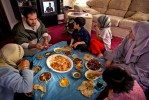 An Iraqi refugee Loey Al-Mosawi of Detroit, 37, eats lunch and with his family from left, Sijoud, 12, Sajad, 10, Baneen, 7, his wife Bushra Al-Maliki, 31, and Heneen, 6, at their home in Dearborn, Michigan. The family, who left Iraq after the war in 1991, hopes to go back to live in post-Saddam Iraq.